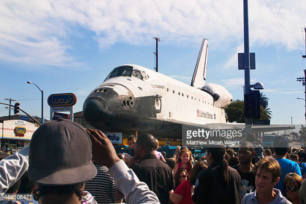 The Space Shuttle moves through Los Angeles