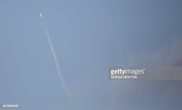 The SpaceX Falcon 9 rocket carrying a Dragon cargo capsule is seen from Port Canaveral Florida as it launches from the Kennedy Space Center Launch...