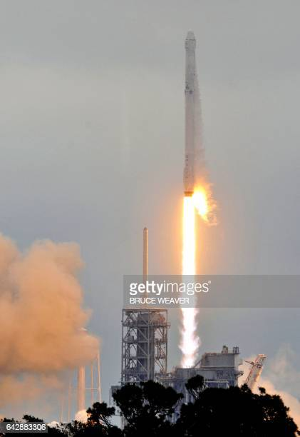 The SpaceX Falcon 9 rocket carrying a Dragon cargo capsule launches from the Kennedy Space Center Launch Complex 39A in Florida on February 19 2017...