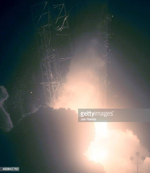 The SpaceX Falcon 9 rocket carrying a Dragon supply ship is seen as it flies into space after lifting off from the launch pad on a resupply mission...