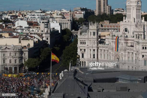 The Spanish flag and the LGTB flag Thousands come to the march of World Pride in Plaza de Cibeles