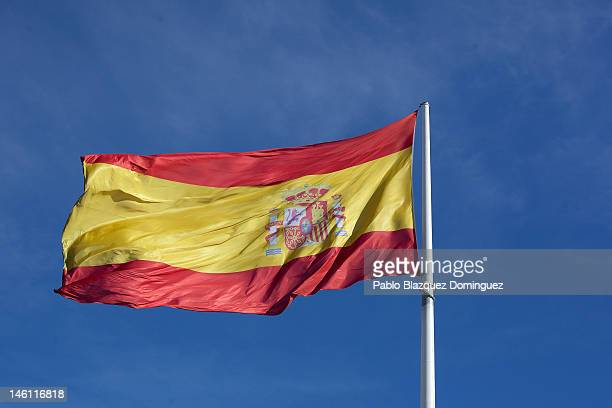 The Spanish flag blow in the wind in Colon Square on June 10 2012 in Madrid Spain Following Spanish Prime Minister Mariano Rajoy's request yesterday...