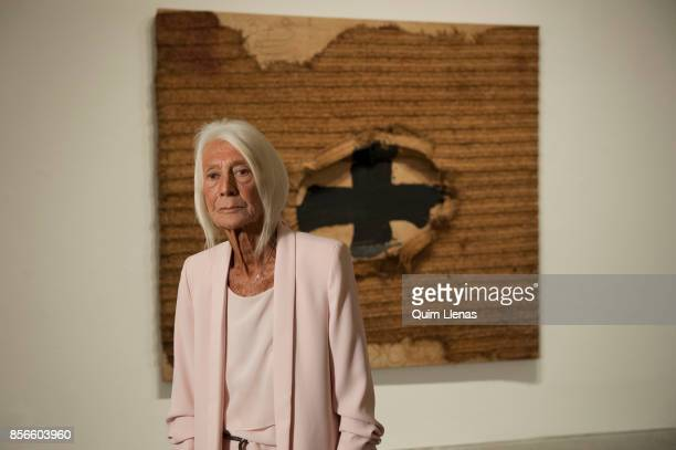 The Spanish gallery owner Soledad Lorenzo poses before the painting 'Estera' by Antoni Tapies during the press preview of the exhibition 'Punto de...
