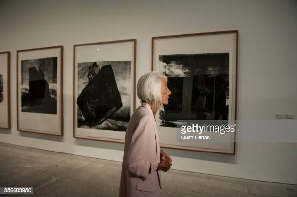 The Spanish gallery owner Soledad Lorenzo walks past the paintings of Jon Mikel Euba during the press preview of the exhibition 'Punto de Encuentro'...