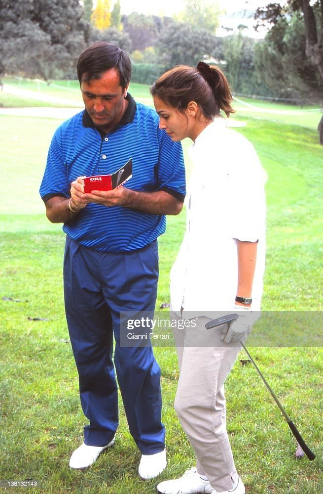 The Spanish golfer Severiano Ballesteros during a friendly match with the Spanish model <a gi-track='captionPersonalityLinkClicked' href=/galleries/search?phrase=Ines+Sastre&family=editorial&specificpeople=206220 ng-click='$event.stopPropagation()'>Ines Sastre</a> in the fields of 'La Moraleja', 1997, Madrid, Spain