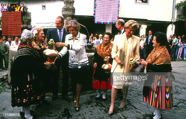 The Spanish Kings of Spain Juan Carlos and Sofia and the Belgian Queen Paola greeting some women in their traditional costumes Caceres Spain