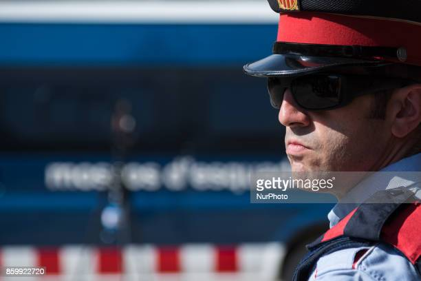 The Spanish Mossos D' Esquadra stand guard at the entrance to the Parliament of Catalonia on October 10 2017 in Barcelona Spain After the October 1...
