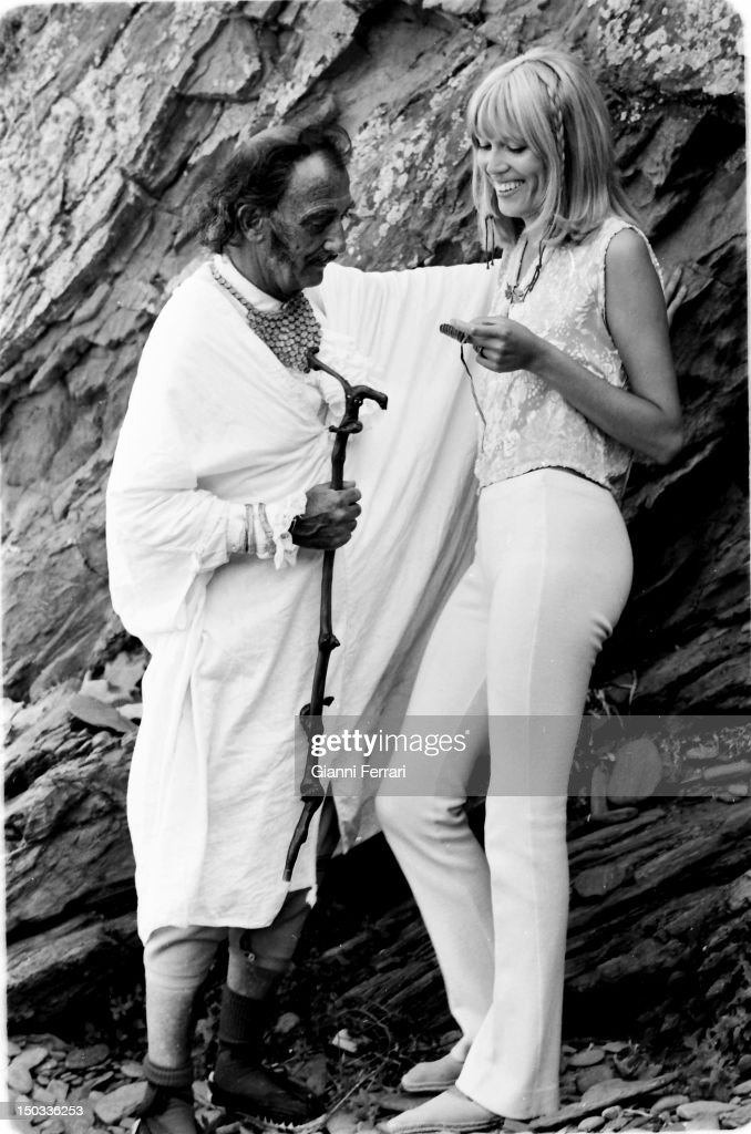 The Spanish painter <a gi-track='captionPersonalityLinkClicked' href=/galleries/search?phrase=Salvador+Dali&family=editorial&specificpeople=94477 ng-click='$event.stopPropagation()'>Salvador Dali</a> with his model and muse <a gi-track='captionPersonalityLinkClicked' href=/galleries/search?phrase=Amanda+Lear&family=editorial&specificpeople=2028746 ng-click='$event.stopPropagation()'>Amanda Lear</a> during of the filming of the Spanish TV program 'Doble Imagen' at his home in Port Lligat, 26th January, 1969, Girona, Spaiin.