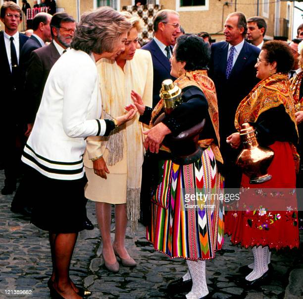 The Spanish Quenn Sofia and the Belgian Queen Paola greeting some women in their traditional costumes Caceres Spain