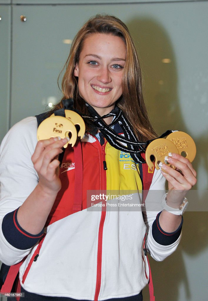 The Spanish swimmer <a gi-track='captionPersonalityLinkClicked' href=/galleries/search?phrase=Mireia+Belmonte&family=editorial&specificpeople=5120453 ng-click='$event.stopPropagation()'>Mireia Belmonte</a> arrives at Barcelona, after winning fourth gold medal at the Fina Short Course World Swimming Championships in Doha, on December 8, 2014 in Barcelona, Spain.