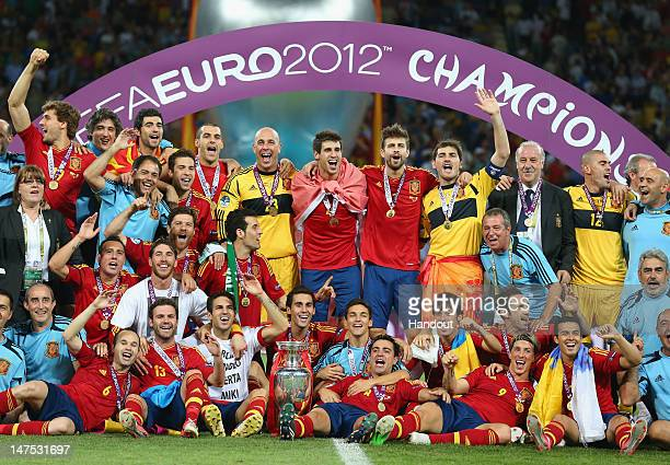 The Spanish team celebrate with the trophy following the UEFA EURO 2012 final match between Spain and Italy at the Olympic Stadium on July 1 2012 in...