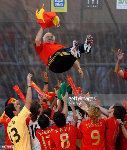 The Spanish team throw their manager Luis Aragones into the air while celebrating with fans at Plaza Colon after winning the UEFA EURO 2008 Final...