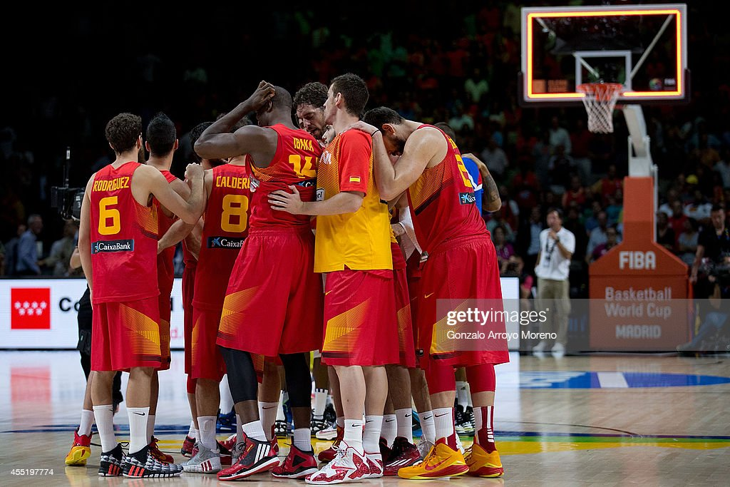 The Spanish team with Pau Gasol on the middle reacts defeated after loosing the 2014 FIBA World Basketball Championship quarter final match between...