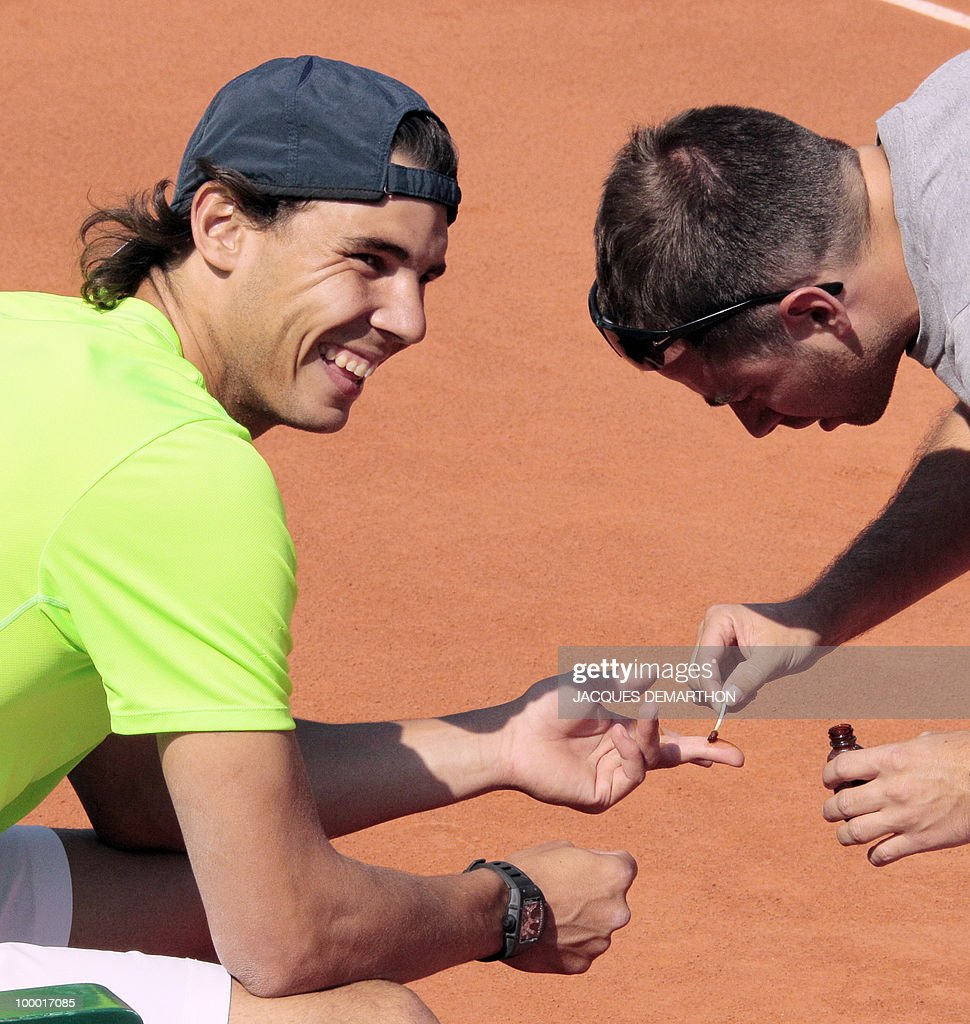 The Spanish world number two Rafael Nadal is treated against blisters prior to a training session on the centre court at Roland-Garros tennis stadium in Paris, on May 20, 2010, three days ahead of the French Open, the second Grand Slam tournament of the season.