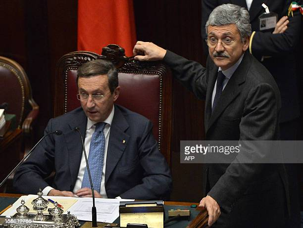 The speaker of the parliament Gianfranco Fini chats with member of parliament Massimo D'Alema during a session on a key budget vote on December 21...
