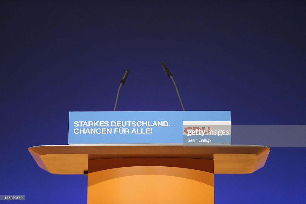 The speaker's podium stands illuminated during preparations for the German Christian Democratic Union (CDU) federal party convention on December 3, 2012 in Hanover, Germany. The CDU is the party of German Chancellor Angela Merkel and faces German federal elections in 2013.