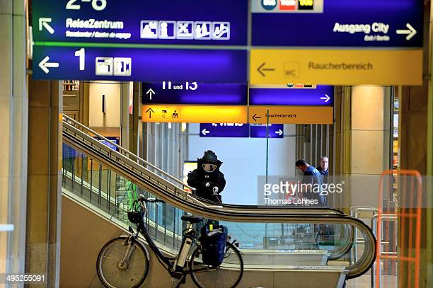 The specalist for explosive substance of the Federal Police is walking to lockers in the main railway station on May 27 2014 in Mainz Germany During...