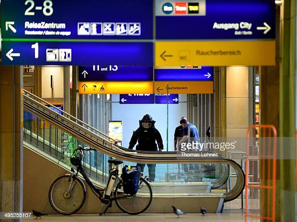 The specalist for explosive substance of the Federal Police walks to lockers in the main railway station on May 27 2014 in Mainz Germany During...