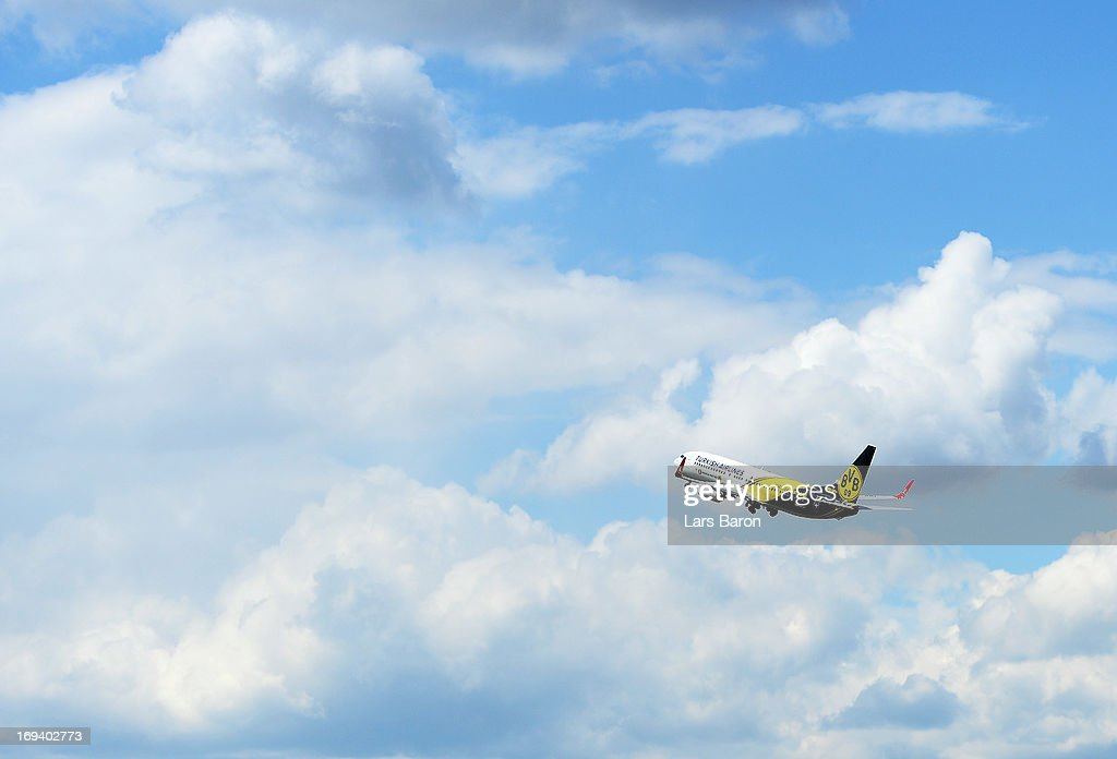 The special branded aircraft with the team of Borussia Dortmund on board is seen during their departure at Dortmund Airport on the eve of the UEFA Champions League Final on May 24, 2013 in Dortmund, Germany.