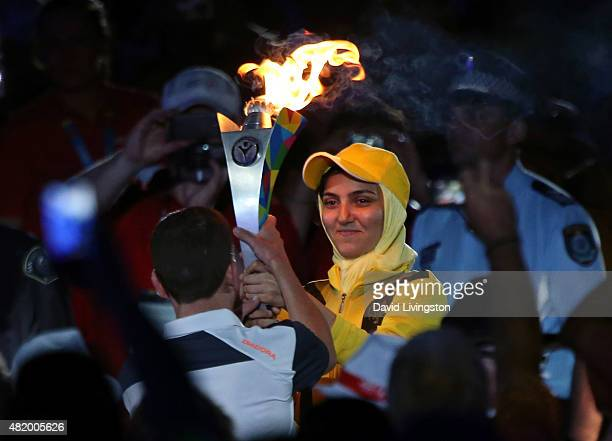 The Special Olympics torch is carried at the opening ceremony of the Special Olympics World Games Los Angeles 2015 at the Los Angeles Memorial...