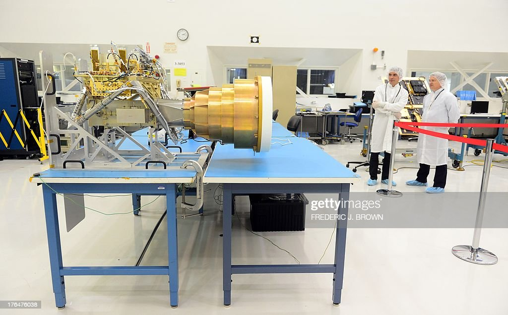 The speed assembly feed for the radar for the SMAP Spacecraft is seen at the Spacecraft Assembly Facility Cleanroom at the Jet Propulsion Laboratory in Pasadena, California on August 13, 2013, where NASA Administrator Charles Bolden came to see the progress and assembly of the Soil Moisture Active Passive (SMAP) satellite presently under construction and due to launch in October 2014. SMAP will produce global maps of soil moisture for tracking water availability around the planet, and will also detect winter freeze and spring thaw to track changes in growing season patterns, allowing scientists to determine how much carbon plants take up from the atmosphere each year. AFP PHOTO/Frederic J. BROWN