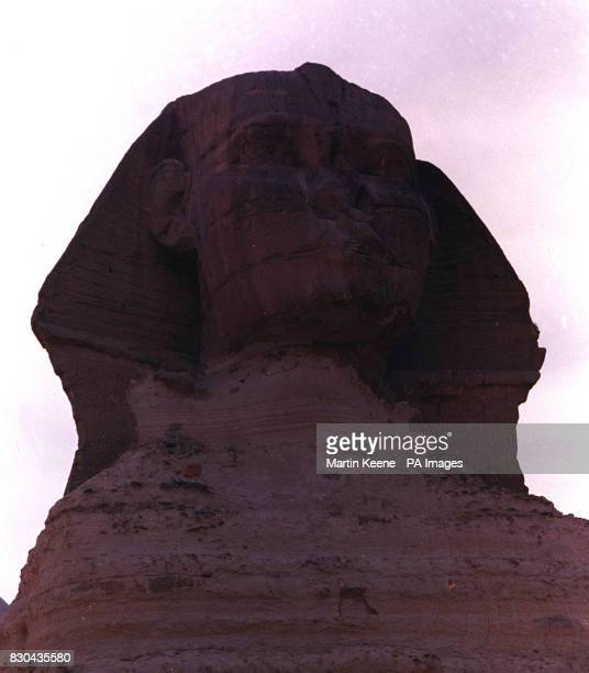 The Sphinx outside Cairo a humanheaded lion statue which is thought by many to stand guard over the nearby Pyramids