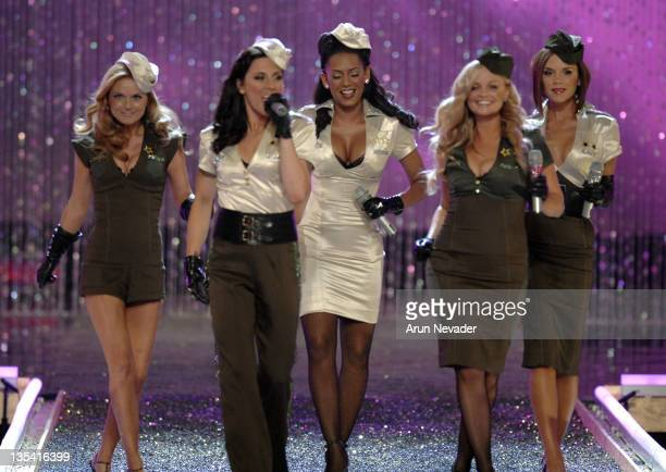 The Spice Girls Geri Halliwell Melanie Chisholm Melanie Brown Emma Bunton and Victoria Beckham perform at the 12th Victoria's Secret Fashion show at...