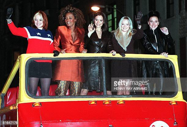 The Spice Girls' Ginger Spice Scary Spice Posh Spice Baby Spice and Sporty Spice arrive atop a double decker bus for a screening of their new movie...