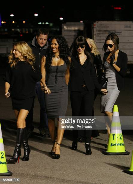 The Spice Girls try to hide the injured Emma Bunton before they unveil the new name Spice One of a Virgin Atlantic Jet at the Flight Path Museum at...