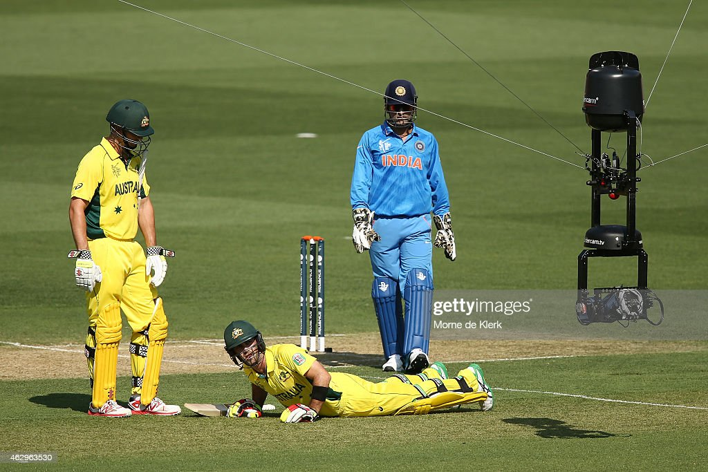 The Spider Cam is visible as Glenn Maxwell of Australia reacts after getting cramps during the ICC Cricket World Cup warm up match between Australia...