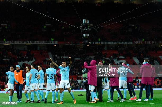 The Spider Camera hangs above as Manchester City's English midfielder Fabian Delph celebrates at the end of the English Premier League football match...