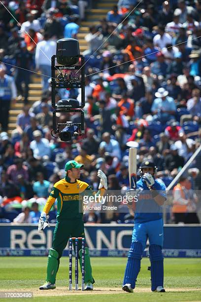 The spidercam hovers above Virat Kohli of India and wicketkeeper AB de Villiers of South Africa during the Group B ICC Champions Trophy match between...