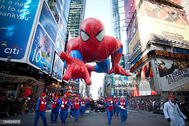The Spiderman balloon makes its way through Times Square in Macy's Thanksgiving Day parade on November 24 2011 in New York City The 85th annual event...
