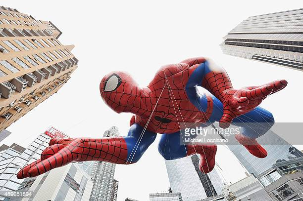 The Spiderman balloon passes by during the 88th annual Macy's Thanksgiving Day Parade on November 27 2014 in New York City Over 8000 people took part...