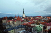 The spire of StOlaf's church rises above buildings in the old town area of Tallinn Estonia on Monday Nov 14 2011 Estonia won't rule out tighter...