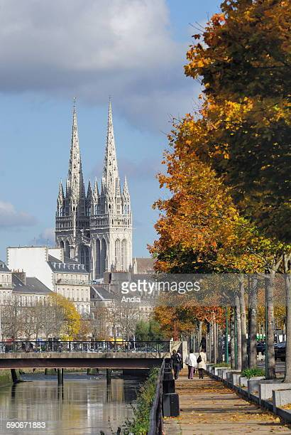 The spires of the cathedral 'Saint Corentin' and the quays of the Odet river in autumn in Quimper