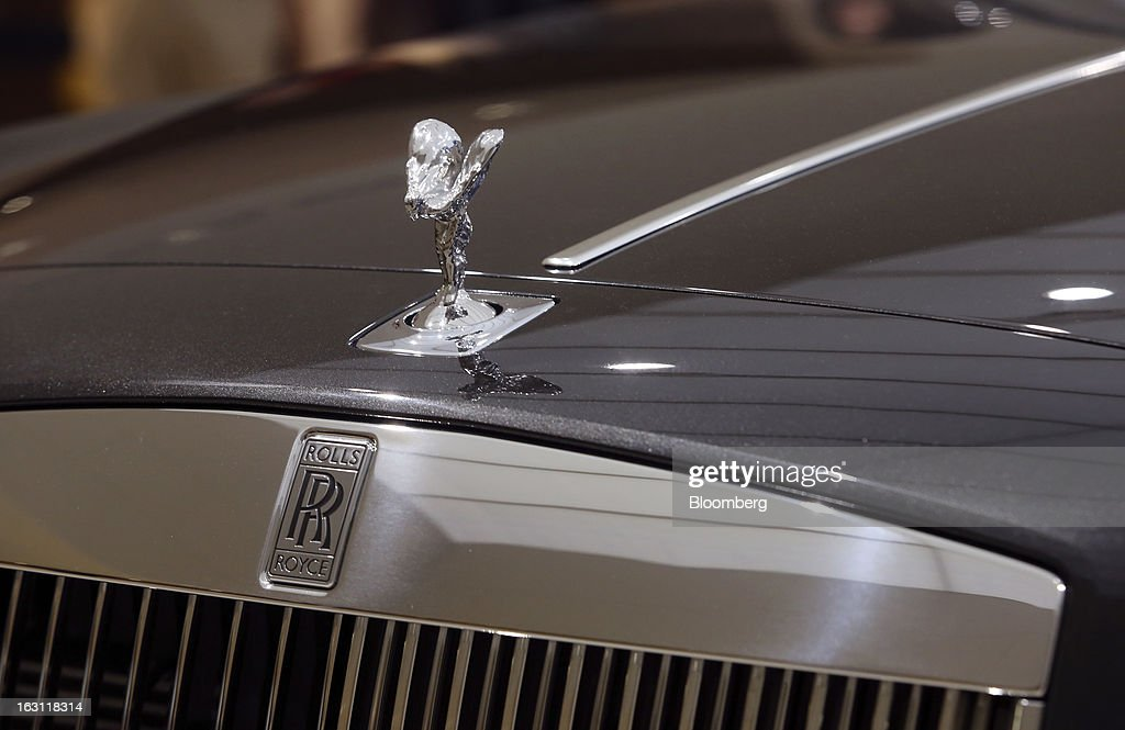 The Spirit of Ecstasy or 'Flying Lady' mascot sits on a Rolls-Royce Wraith automobile, produced by Rolls-Royce Motor Cars Ltd., ahead of the opening day of the 83rd Geneva International Motor Show in Geneva, Switzerland, on Monday, March 4, 2013. This year's show opens to the public on Mar. 7, and is set to feature more than 100 product premiers from the world's automobile manufacturers. Photographer: Chris Ratcliffe/Bloomberg via Getty Images