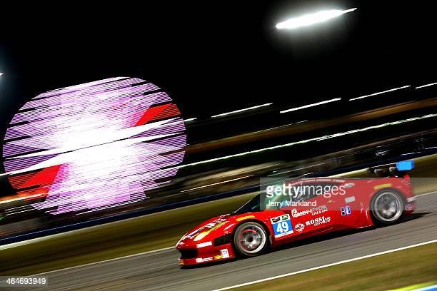 The Spirit of Race Ferrarri 458 Italia driven by Piergiuseppe Peerazzini Gialuca Roda Paolo Ruberti and David Rigon during night practice for the...