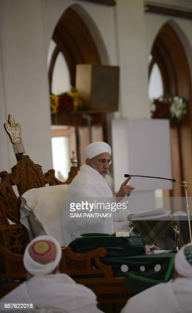 The Spiritual leader of Dawoodi Bohra Muslims Syedna Mufaddal Saifuddin addresses his followers at a mosque in Ahmedabad on March 25 2017 / AFP PHOTO...