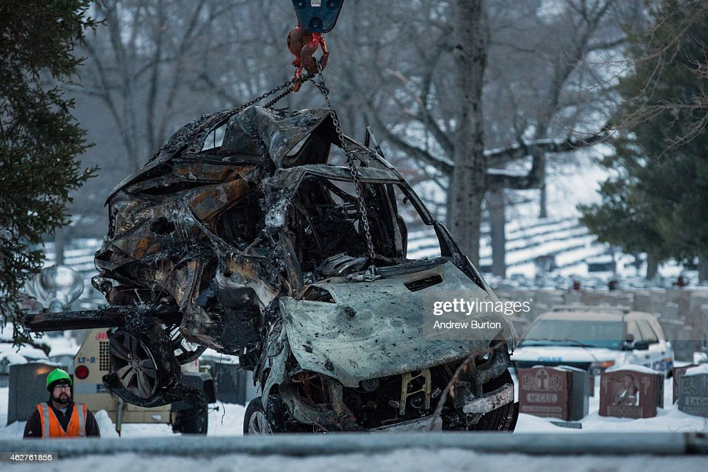 The sport utility vehicle that was hit by a Metro-North train is removed from the site of the accident on February 4, 2015 in Valhalla, New York. The crash started a fire in the train car that killed seven people, including the driver of the vehicle.