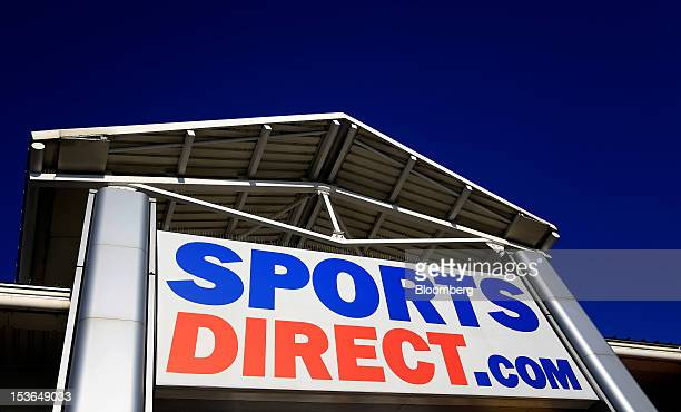The Sports Direct International Plc logo is displayed outside one of the company's stores in Urmston UK on Saturday Oct 6 2012 JJB Sports Plc a UK...