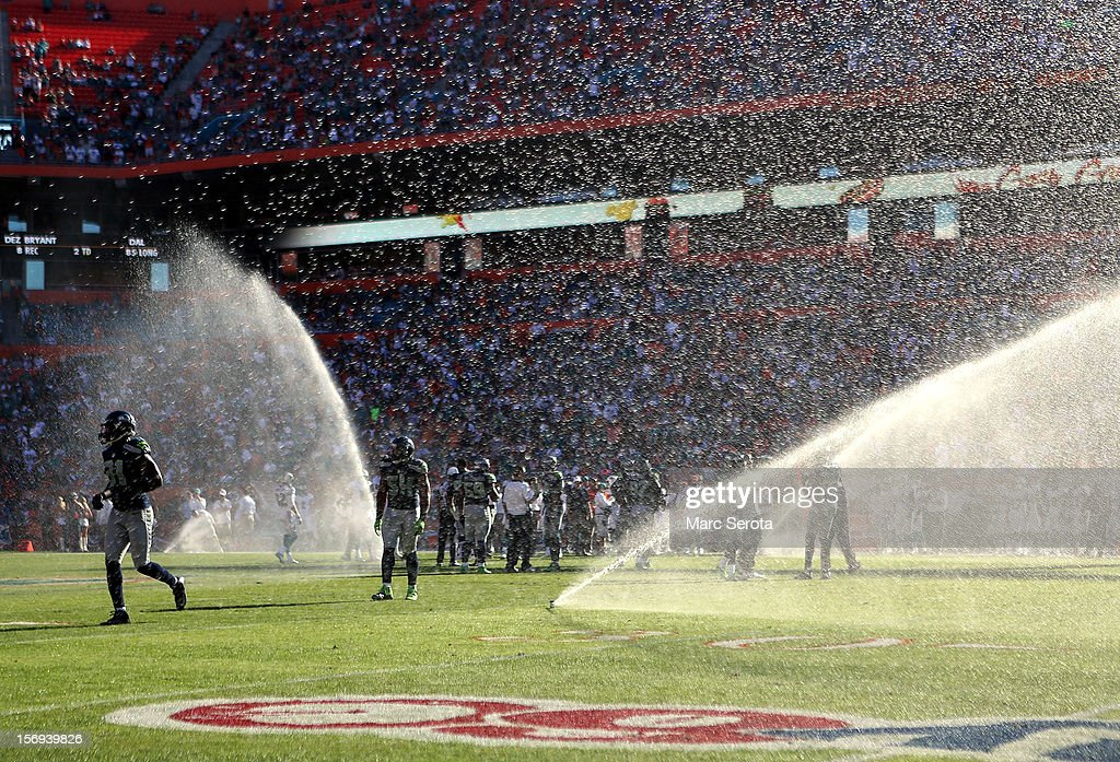 The sprinklers go off as the Miami Dolphins play against the Seattle Seahawks at Sun Life Stadium on November 25, 2012 in Miami Gardens, Florida. Miami defeated Seattle 24-21.