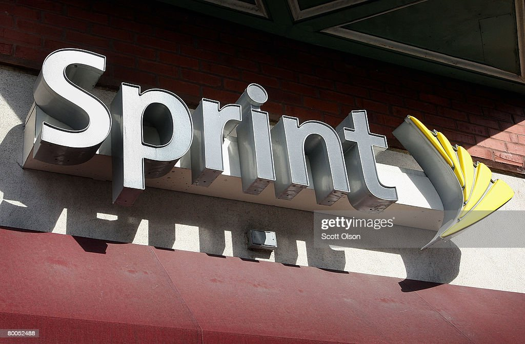 The Sprint Nextel logo hangs above a Sprint retail store February 28, 2008 in Chicago Illinois. Sprint said it lost $29.5 billion during the quarter ending Dec. 31.