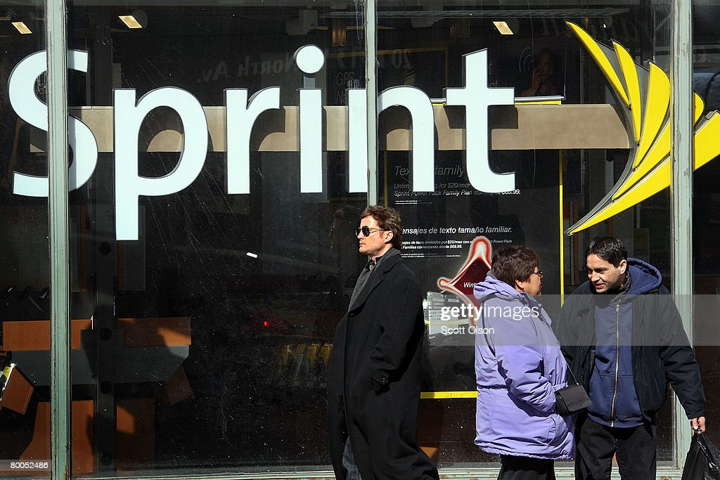 The Sprint Nextel logo hangs in the window of a Sprint retail store February 28, 2008 in Chicago Illinois. Sprint said it lost $29.5 billion during the quarter ending Dec. 31.