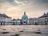 low angle view of Frederikskirken, or Marmorkirken, or Marble Church, seen from the Rococo Amalienborg Palads, Copenhagen, Denmark,
