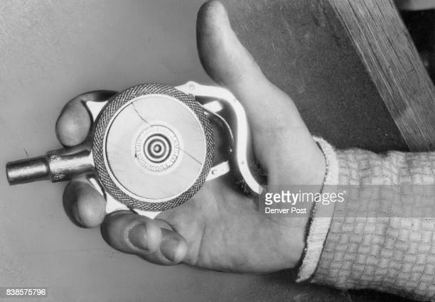 The Squeeze Gun Here's the gun Brewer says was once carried by Scarface Al Capone It shoots nine 32 caliber slugs each loading Credit The Denver Post