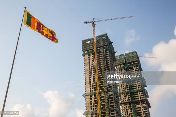 The Sri Lankan national flag flies at Galle Face Green as the under construction ShangriLa Hotel Colombo stands in the background in Colombo Sri...