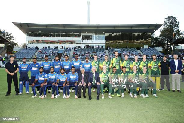 The Sri Lankan Prime Minister Ranil Wickremesinghe and Prime Minister of Australia Malcolm Turnbull pose with both teams prior to the T20 warm up...