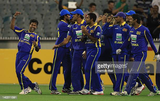The Sri Lankan team celebrate their victory during the One Day International match between Australia and Sri Lanka at Melbourne Cricket Ground on...