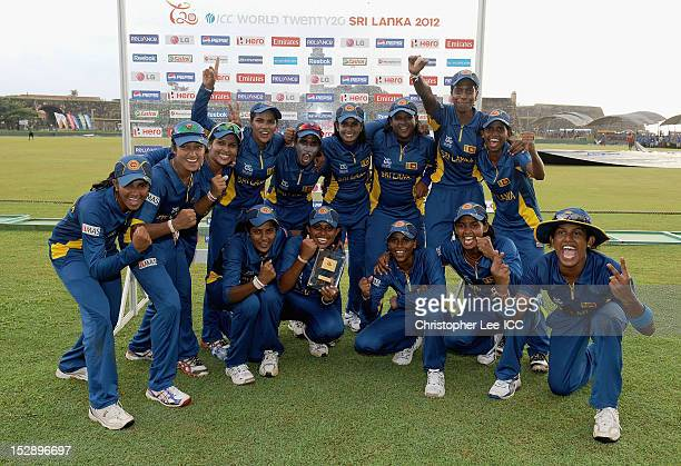 The Sri Lankan team celebrate their victory with the Player of the Match award which was awarded to Chamani Seneviratne during the ICC Women's World...